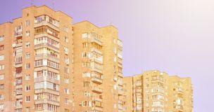 Detailed photo of multi-storey residential building with lots of balconies and windows. Hostels for poor people in Russia and Ukr Royalty Free Stock Photography