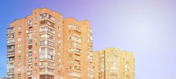 Detailed photo of multi-storey residential building with lots of balconies and windows. Hostels for poor people in Russia and Ukr Royalty Free Stock Photos