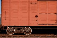 Detailed photo of railway freight car. A fragment of the component parts of the freight car on the railroad in dayligh. T royalty free stock images