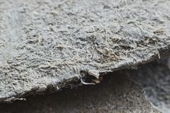 Detailed photography of roof covering material with asbestos fibres. Health harmful and hazards effects. royalty free stock images