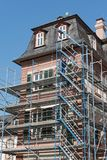 Detailed picture of a castle renovation with scaffolding framework.  Royalty Free Stock Photo