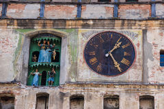 Detailed picture of the Clock Tower in Sighisoara. A close up of the clock and figurines in the clock Tower of Sighisoara, Romania. The picture shows one of the Royalty Free Stock Image