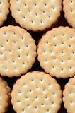 Detailed picture of round sandwich cookies with coconut filling. Background image of a close-up of several treats for tea royalty free stock photo
