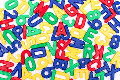 Detailed plastic letters on a pure white background Stock Images