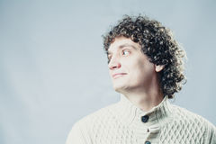Detailed portrait of a young guy with curly hair Royalty Free Stock Images