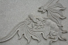 Detailed sculpture of dragon with wings Stock Photos