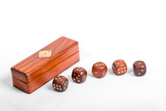 Detailed set of wooden dices. With a box on white background Stock Photos