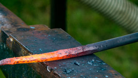 Detailed shot of metal being worked at a blacksmith forge Royalty Free Stock Photo