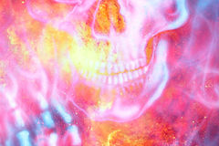 Detailed skull mouth in color cosmic abstract background. Fire effect. Royalty Free Stock Photos