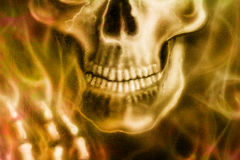 Detailed skull and skeleton hand and  fire, on black background. Royalty Free Stock Images