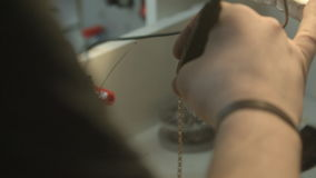 Detailed small work with silver. stock footage