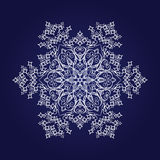 Detailed snowflake on dark blue background Royalty Free Stock Photography
