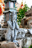 Detailed statue and architecture in Wat Pho, Buddhist temple, Bangkok, Thailand. Wat Pho known also as the Temple of the Reclining Buddha Royalty Free Stock Image