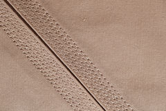 Detailed stitching of Kandura, the ankle-length garment Stock Image