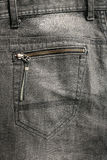 Detailed Texture: back pocket of black jeans. Background Stock Image