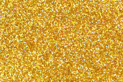 Detailed texture of glittering golden dust surface. stock photos