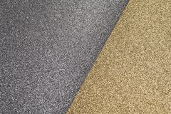 Detailed texture of glittering silver and gold dust surface for christmas royalty free stock photography