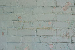 Detailed  texture. Old brick wall with shabby stucco. Stock Photo