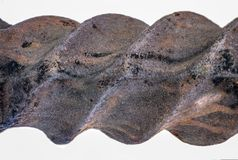 Detailed texture of an old forged twisted metal with rust. Part of metal forged twisted fence stock images