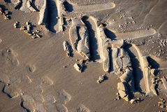 Detailed tire tracks on a beach Stock Images