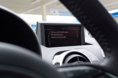 Detailed view of an active car display and a steering wheel in the blurred front Royalty Free Stock Photography