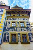 A detailed view of the beautiful House at the Minute, located near the Old Town Square in Prague. Czech Republic. Decorated with sgraffito, it is an example of Stock Photos