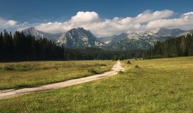 A detailed view at the beautiful mountains in the Durmitor national park with a road leading towards the mountain royalty free stock images