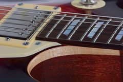 Detailed view on the brown electric guitar Royalty Free Stock Image