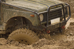 Detailed view of the car in a muddy puddle Stock Images