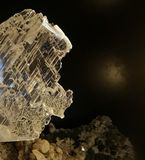 Detailed view of a clear crystal. Detailed view of a clear, glass or white crystal on a base of composite minerals and other crystals Stock Images