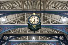 Detailed view of the colourful wrought ironwork and clock at Smithfield meat market, London UK. Detailed view of the colourful wrought ironwork and clock at royalty free stock image