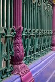 Detailed view of colourful wrought ironwork at Smithfield meat and poultry market in the City of London, UK. Detailed view of the colourful wrought ironwork at stock photography