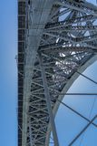 Detailed view at the D. Luis bridge structure, bue sky as background. Porto/Portugal - 10/02/2018 : Detailed view at the D. Luis bridge structure, bue sky as stock images
