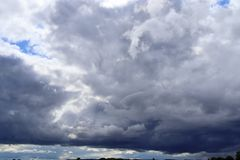 Detailed view on dark clouds forming before a storm. Seen in northern europe royalty free stock photography
