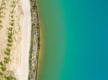 Detailed view of the edge of a rainwater retention basin with turquoise coloured water, abstract effect through vertical angle of. View, Germany royalty free stock photos