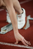 Detailed view of a female sprinter ready to go Royalty Free Stock Images