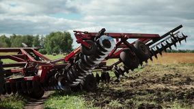 Detailed view of folding disk harrow stock video footage