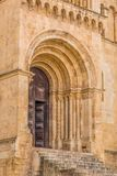 Detailed view of frontal gate of the gothic building of Coimbra Cathedral. Coimbra / Portugal - 04 04 2019 : Detailed view of frontal gate of the gothic building royalty free stock photography