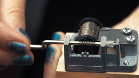 Detailed view of the insides of an old vintage music box as it plays. Slow tracking movements. Detailed view of the insides of an old vintage music box as Girl stock footage