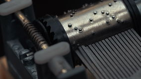 Detailed view of the insides of an old vintage music box as it plays. Slow tracking movements. Detailed view of the insides of an old vintage music box as it stock video