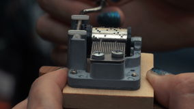 Detailed view of the insides of an old vintage music box as it plays. Slow tracking movements. Detailed view of the insides of an old vintage music box as it stock footage