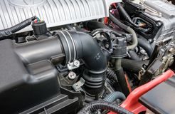 Detailed view of a Japanese manufactured hybrid car engine, showing its detailed parts in a car showroom. royalty free stock photography