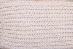 Detailed view on knitwear texture. Knitting pattern and stitches, white woolen yarn Royalty Free Stock Photos