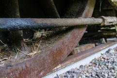 Detailed view of an old, dirty railway wheel. Part of an old locomotive of the railway museum Rio Grande, on track with gravel Royalty Free Stock Photos