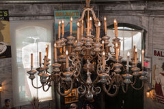 Detailed view of old vintage big classic chandelier in Balzac's cafe. Toronto, Ontario, Canada, May 22, 2016, closeup view of old vintage big classic chandelier Royalty Free Stock Images