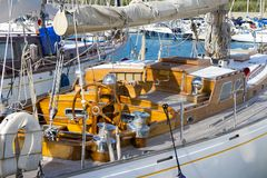 Old sailboat detail. Detailed view of an old white, wooden sailboat at Bolsena lake, near Rome, italy in a clear, sunny day stock images