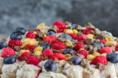 Detailed view on a peaches, chocolate, raspberries and blueberri. Es on a cake with marble background Royalty Free Stock Image