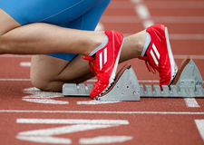 Detailed view of a sprinter. In the starting blocks, on the starting line Stock Photos