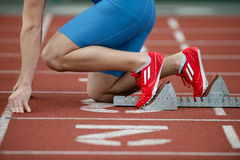 Detailed view of a sprinter in the starting blocks. At the starting line on a running track Stock Images