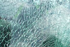 Detailed view of texture of a broken and slivered car window glass stock image